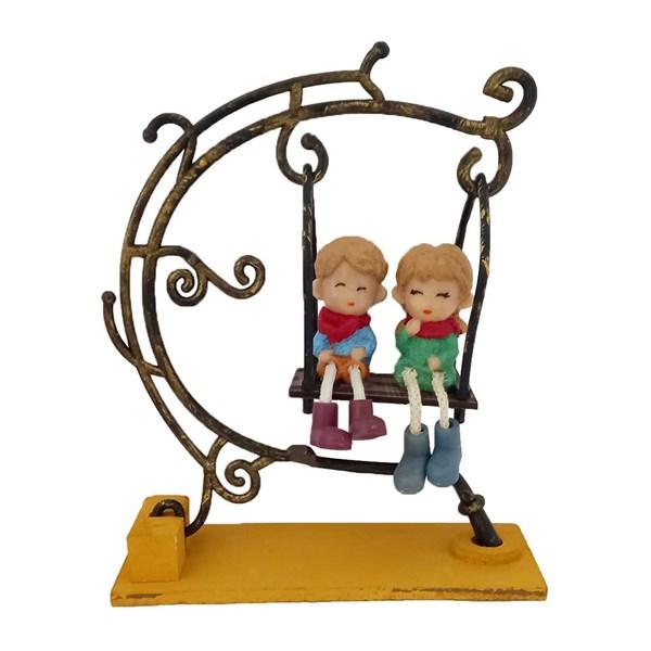 مجسمه دکوری مدل دختر و پسر تاب سوار کد 7741